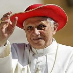 Pope Benedict XVI wears a red hat as he arrives to lead his weekly general audience in Saint Peter's Square at the  Vatican
